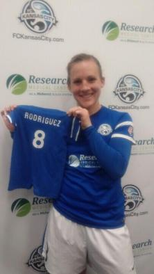 Amy Rodriguez with the baby FCKC kit onsie we made for her son Ryan. (Photo credit to Thad Bell)